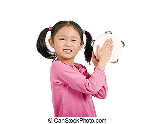 Maracas - A young asian girl playing maracas