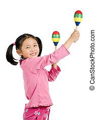 Maracas - A young asian girl playing maracas