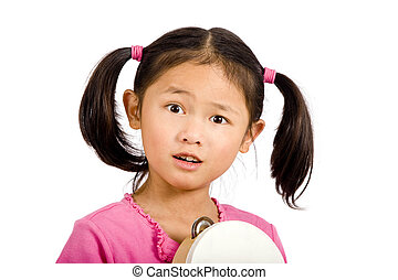 Tambourine - A young asian girl playing a tanbourine