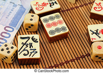 Gaming Pieces With Asian Money