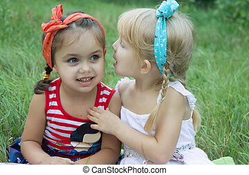 Two girls sharing secrets