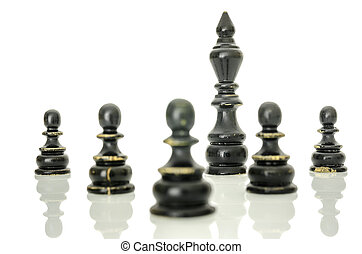 Black king protected with pawns - Old chess figures on white...
