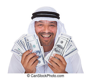 Portrait Of Mature Arab Man Holding Dollars Over White...
