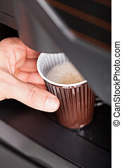 Close up of automatic coffee machine - Coffee maker pouring...