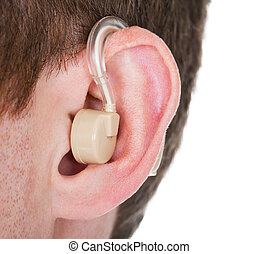 Hearing Aid On The Mans Ear - Close-up Of Hearing Aid On The...
