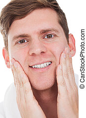 Close-up Of Man After Shaved Isolated Over White Background