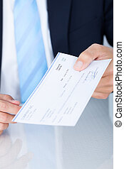 Businessman Holding Cheque - Portrait Of Young Happy...