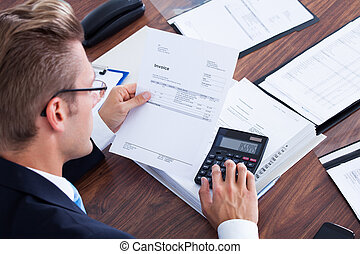 Businessman Using Calculator - Portrait Of Young Businessman...