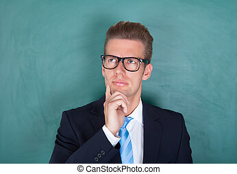 Portrait Of Thoughtful Male Professor - Male Contemplated...