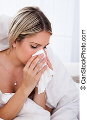 Sick woman blowing her nose - Infected woman blowing his...