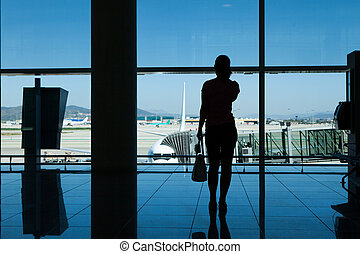 Silhouette of women in airport terminal - Silhouette of...