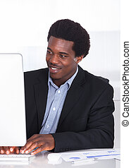 Happy Businessman Working On Computer