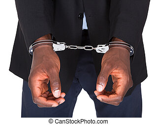 Arrested Man With Handcuffed Hands - African Man With...