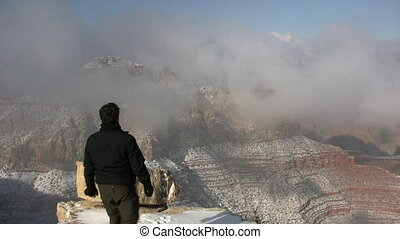 Grand Canyon Tourist in Winter - a tourist in awe of the...