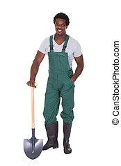 jardineiro, segurando, pá
