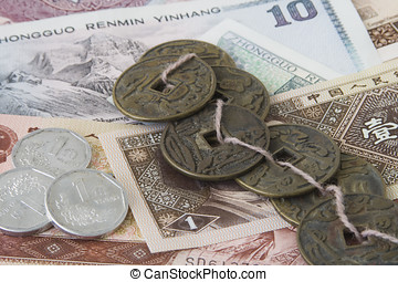 Chinese money, old and new - Old chinese coins on a string,...
