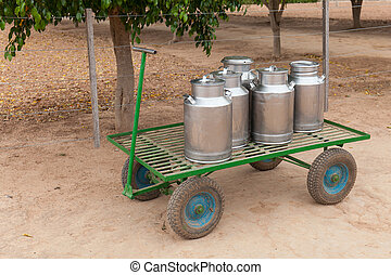 Milk cans on a cart - milk cans in farm of Menonits in...
