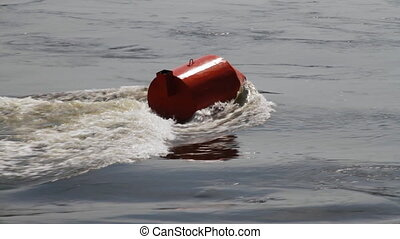 Red buoy in a river - Threshold on river. Floating red buoy...