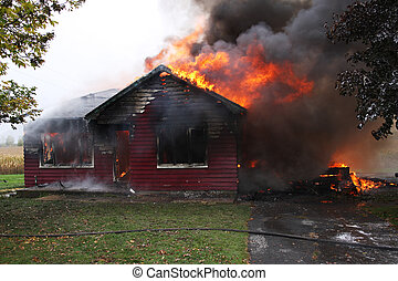 Abandoned house in flame, house is still up but flames are...