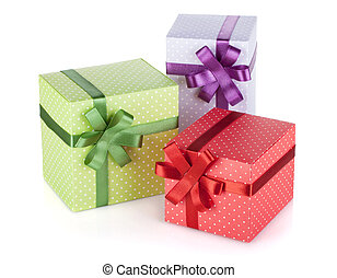 Three colorful gift boxes with ribbon and bow. Isolated on...