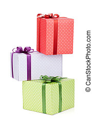 Three gift boxes with ribbon and bow. Isolated on white...