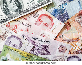 a collection of various currencies from countries the globe