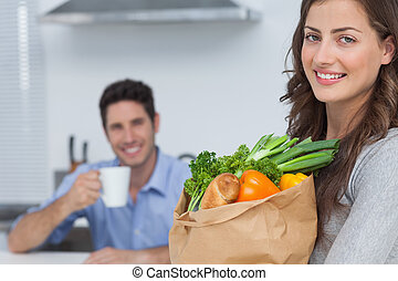 Woman with groceries bag