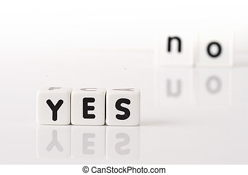 Yes No Concept - Yes spelled in dice letters in foreground...