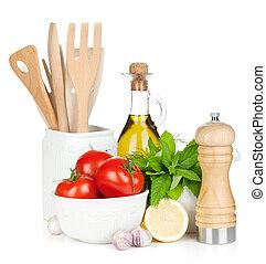 Fresh ripe vegetables, condiments and kitchen utensils....