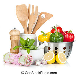 Fresh ripe vegetables, condiments and kitchen utensils...