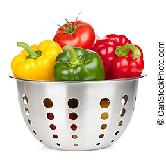 Fresh ripe vegetables in colander Isolated on white...
