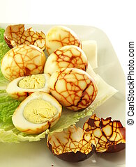 Chinese tea eggs and the eggshells on plate