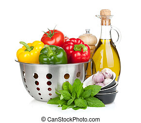 Fresh ripe vegetables in colander, herbs and condiments...