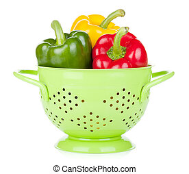 Fresh ripe bell peppers in colander Isolated on white...