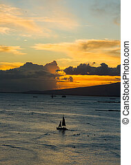 Sunset over Waikiki - Sunset with the sailboats in the ocean