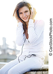 Delightful young woman listening to