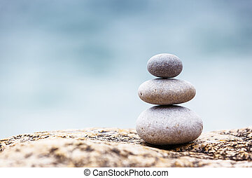 stone - Stones balance, pebbles stack over blue sea. Crimea,...