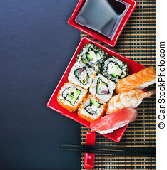 sushi and chopstick on a black background for text -...