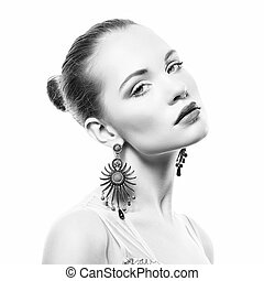 Portrait of beautiful young woman with earring
