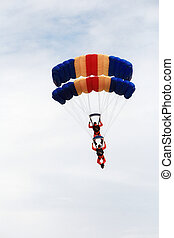 skydiver duo - two skydivers in cascade formation before...