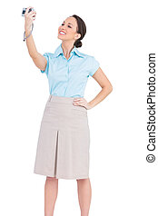 Smiling classy businesswoman taking picture of herself while...