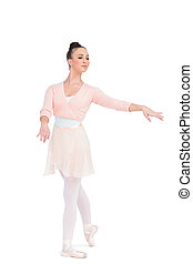 Calm attractive ballerina posing with her arms extended -...