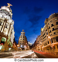 Gran via street, Madrid, Spain. - Rays of traffic lights on...