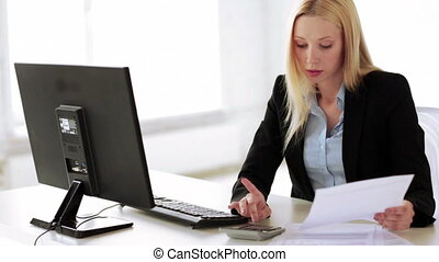 attractive office worker - attractive business woman working...