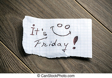 Its Friday - Hand writing text on a piece of paper on wood...