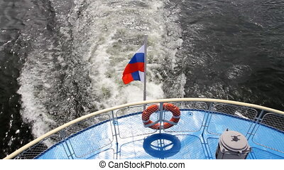 Passenger ship on river. - Ship floats. Flag of Russia....