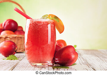 Fresh healthy drink - Fresh harvested nectarines mixed into...