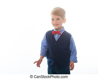 Little boy in blue vest with red bow tie isolated on white...
