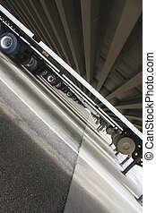 Tilted view under semi trailers, in the middle of the day,...