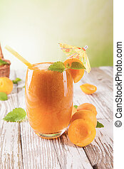 Fresh healthy drink - Fresh harvested apricots mixed into...